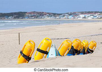 Beach with lifesaving flotation devices