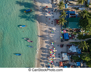 beach with resorts a and boats