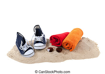 Beach with sand and towels