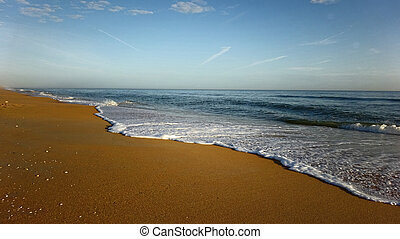 Beach with Sea Shore Line and Warm Sand