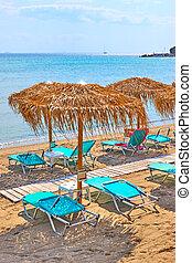 Beach with straw umbrellas