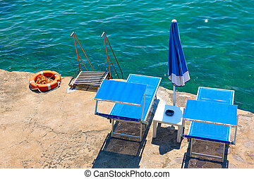 Beach with two sunbeds