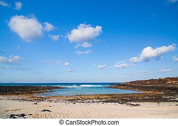 Beach with volcanic stones