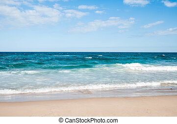 Beach with waves on a sunny day