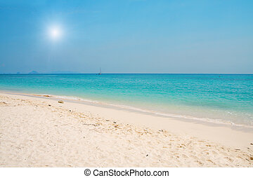 beach with white sand and  blue sea