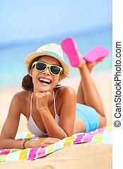 Beach woman laughing fun in summer