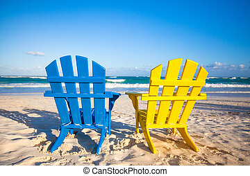 Beach wooden colorful chairs for vacations and summer...