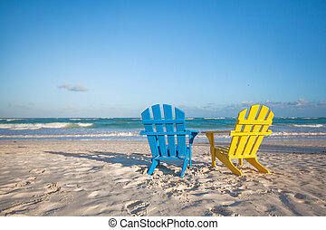 Beach wooden colorful chairs for vacations on tropical beach...