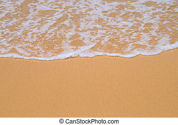 Beach yellow sand covered with wave white foam background.