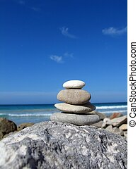 Beach zen - Composition of pebble stacks on beach background