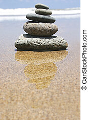 Beach Zen - Pebble stack by the seashore