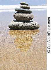 Beach Zen - Pebble stack by the seashore