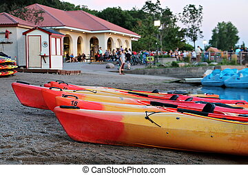 Kayaks are beached in front of the pavilion on the north side of Lake Calhoun in Minneapolis, Minnesota.