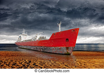 Beached ship - Big ship aground due to a severe storm -...