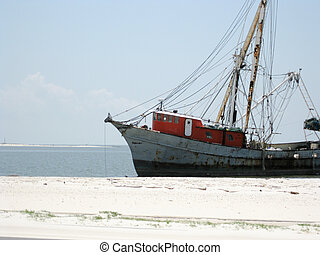 Beached Shrimp boat after a hurricane.