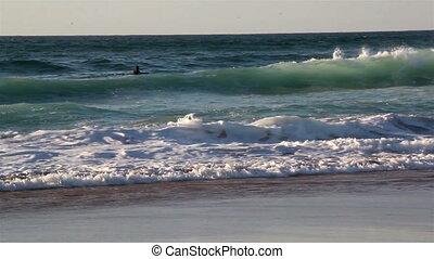Beaches Bbg waves splashing and approaching the sea shore -...