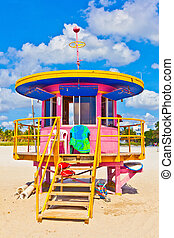 wooden colorful beach watch hut at the beautiful white beach