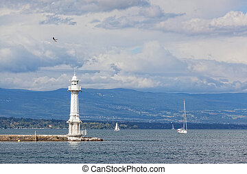 Beacon and the sailing yacht on the lake Leman in Geneva