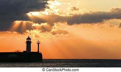 Beacon in Yalta at sunrise, a view from the central city embankment, the Crimea