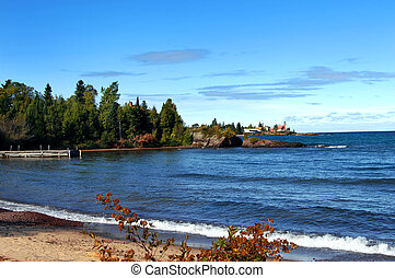 Beacon on Keweenaw Peninsula - Wooden pier fronts image; ...