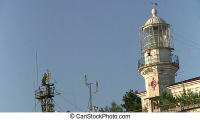 beacon - working lighthouse on the shore of the sea
