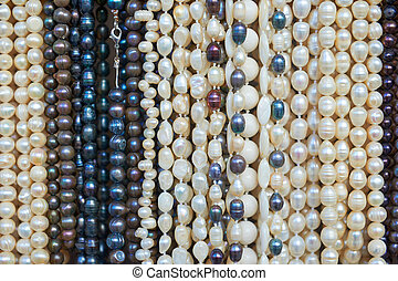 Bead necklaces displayed for sale