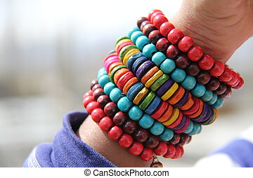 Beaded bracelet - A colorful beaded bracelet around a wrist