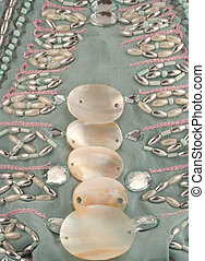 beaded material - embroidered material with shells, beads, ...