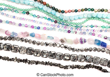 Beads strands - Natural semi-precious beads strands on white...