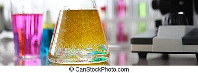 Beaker with coloured liquid in lab