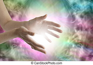 Outstretched female healing hands with white light between and a vibrant multicolored flowing energy field background