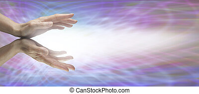 Healer's outstretched hands with energy beaming outwards on a purple matrix background