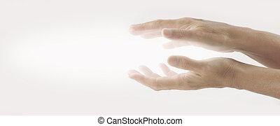 Beaming Reiki Healing Energy - Pair of female hands held...