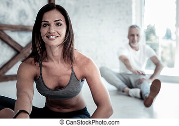 Beaming young lady getting excited over yoga session