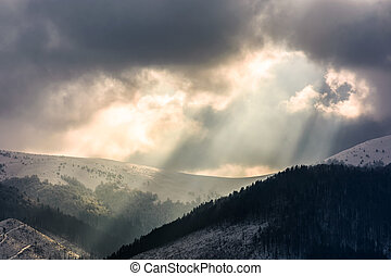 beams of light over the mountains. gorgeous scenery on a...