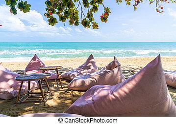 bean bag on beach with ocean sea background