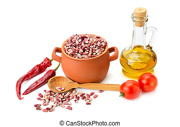 beans in a ceramic pot, cooking oil and vegetables isolated on white background