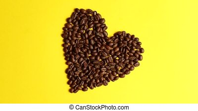 Beans laid in shape of heart - From above view of coffee...
