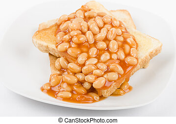 Beans on Toast - Slices of toasted white bread, buttered and...