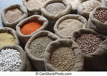 Beans, rice, lentils, oats, wheat, rye and barley in jute ...