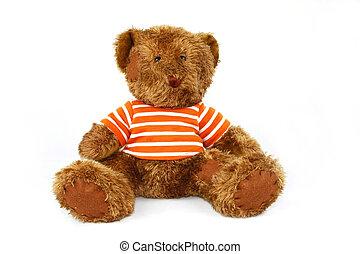 A brown plush teddy bear