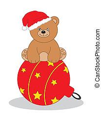 Bear sitting on a Christmas tree ba