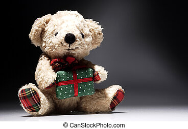 bear soft toys with gift on background nuanced