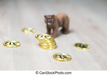 Bear With Gold Bitcoin Cryptocurrency focus on coins. Bear Market Wall Street Financial Concept.