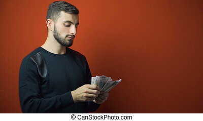 Beard Man in Black Counts Dollars Banknotes