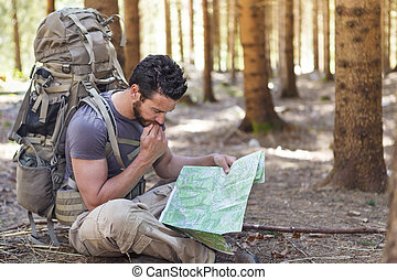 Man with Backpack and map searching directions - Beard Man ...
