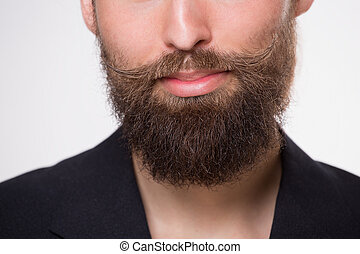Beard - Young man with beard smiling on white