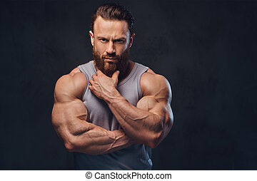 Bearded bodybuilder dressed in a tank top. - Portrait of ...