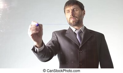 bearded businessman draws the schedule, circuit block and...