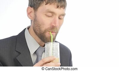bearded businessman drinks detox smoothie, healthy lifestyle...